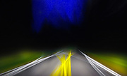 converging lines on the highway after dark