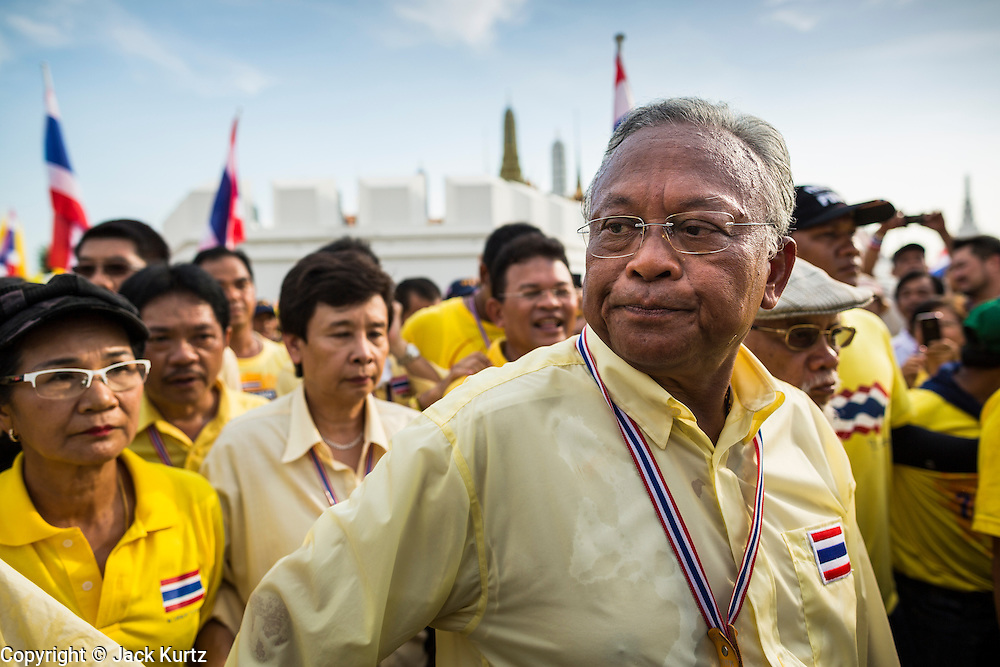 05 MAY 2104 - BANGKOK, THAILAND:  SUTHEP THAUGSUBAN leads a march of anti-government protesters to Sanam Luang in Bangkok. Thousands of Thais packed the area around Sanam Luang and the Grand Palace Monday evening for a special ceremony to mark Coronation Day, which honored the 64th anniversary of the coronation of Bhumibol Adulyadej, the King of Thailand. Many of the people also support the anti-government movement led by Suthep Thaugsuban. Most of the anti-government protesters are conservative supporters of the monarchy.   PHOTO BY JACK KURTZ