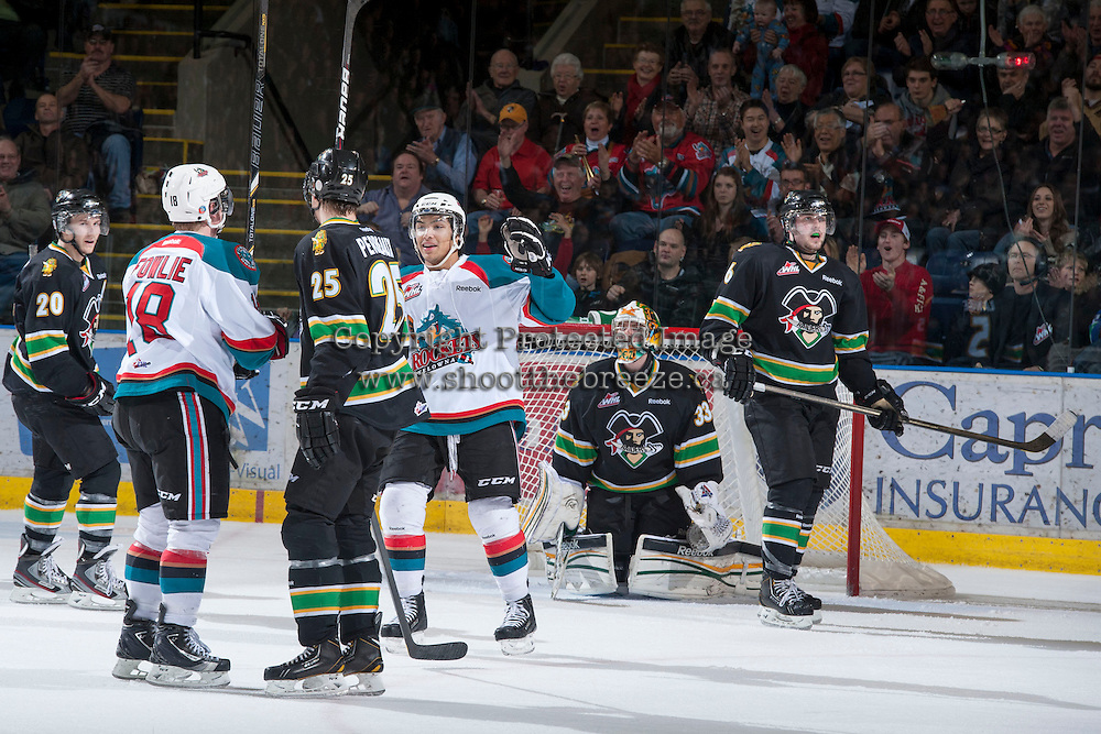 KELOWNA, CANADA - JANUARY 26:Cody Fowlie #18 and Tyrell Goulbourne #12 of the Kelowna Rockets celebrate a goal against the Prince Albert Raiders at the Kelowna Rockets on January 26, 2013 at Prospera Place in Kelowna, British Columbia, Canada (Photo by Marissa Baecker/Shoot the Breeze) *** Local Caption ***