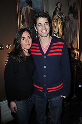ADAM GARCIA and DIANA VERVENIETO at a party to celebrate the publication of her new book - Kelly Hoppen: Ideas, held at Beach Blanket Babylon, 45 Ledbury Road, London W11 on 4th April 2011.
