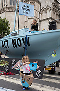 "Environmental and climate change protesters block Fleet Street on the first day of a week-long country-wide protests using using five boats to stop traffic in Cardiff, Glasgow, Bristol, Leeds, and London, on 15th July 2019, in London, England. The group is calling on the government to declare a climate emergency, saying it was beginning a five-day ""summer uprising"" and that 'Ecocide' ought to be a criminal offence in law."
