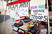 "Sept. 19 - PHOENIX, AZ: A tent put up by protesters supporting the DREAM Act in Phoenix Sunday. About 30 people met in front of US Sen. John McCain's office in Phoenix Sunday night to demonstrate in support of the DREAM Act, which is scheduled to be debated in the US Senate on Tuesday, Sept 21. The Development, Relief and Education for Alien Minors Act (The ""DREAM Act"") is a piece of proposed federal legislation in the United States that was introduced in the United States Senate, and the United States House of Representatives on March 26, 2009. This bill would provide certain illegal immigrant students who graduate from US high schools, who are of good moral character, arrived in the U.S. as minors, and have been in the country continuously for at least five years prior to the bill's enactment, the opportunity to earn conditional permanent residency. In the early part of this decade McCain supported legislation similar to the DREAM Act, but his position on immigration has hardened in the last two years and he no longer supports it. The protesters, mostly area students, marched and drilled to show their support for the US military and then held a candle light vigil.   Photo by Jack Kurtz"