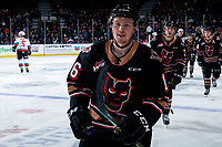 KELOWNA, BC - FEBRUARY 17: Kyle Olson #16 of the Calgary Hitmen skates to the bench to celebrate a third period goal against the Kelowna Rockets at Prospera Place on February 17, 2020 in Kelowna, Canada. (Photo by Marissa Baecker/Shoot the Breeze)