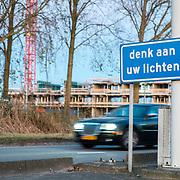 """NLD/Amsterdam/20161125 - Bord """"Denk aan uw Lichten"""" bij de Zeeburgertunnel in Amsterdam,"""