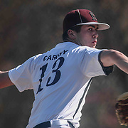 Caravel Academy Pitcher Bryce Carney (13) attempts to throws a pitch during a regular season baseball game between the St. Marks Spartans and Caravel Academy at St. Marks Stadium Thursday April 14, 2016 in Wilmington.