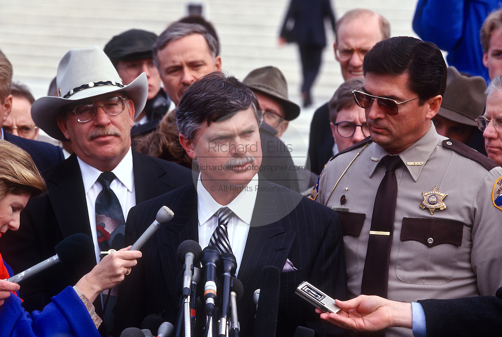 Attorney Stephen Halbrook talks to the media outside the Supreme Court in Washington Tuesday, Dec. 3, 1996, after a hearing to discuss the Brady gun-control law. Halbrook is representing Sherif Jay Printz (L) and Richard Mack (R).