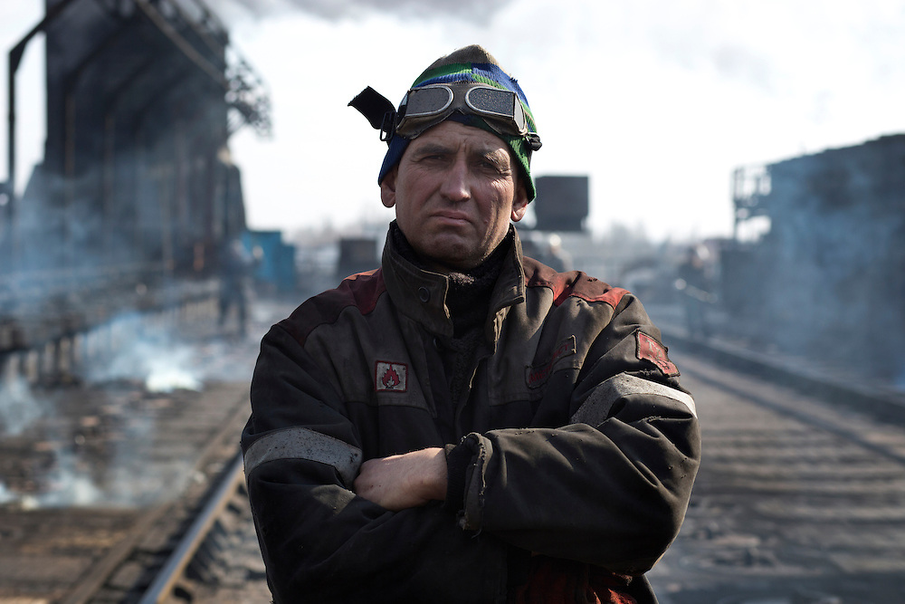 A worker at the Metinvest Coke Plant poses for a portrait on March 18, 2015 in Avdiivka, Ukraine. Shells have hit the property of the plant over 150 times, including multiple hits on the plant itself.