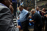 Rev. Jesse Jackson, center, and Charlotte, NC Mayor Anthony Foxx, second from right, are prepped with mmicrophones before appearing as guests on Hardball with Chris Matthews at the MSNBC EpiCentre the day before the opening of the 2012 Democratic National Convention on Monday, September 3, 2012 in Charlotte, NC. Jackson will give opening remarks for the convention.