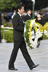 71. Jahrestag des Atombombenabwurfs in Hiroshima / 060816<br /> <br /> ***Japanese Prime Minister Shinzo Abe lays flowers at the cenotaph for the U.S. atomic bombing victims at the Hiroshima Peace Memorial Park on Aug. 6, 2016, the 71st anniversary of the tragedy***