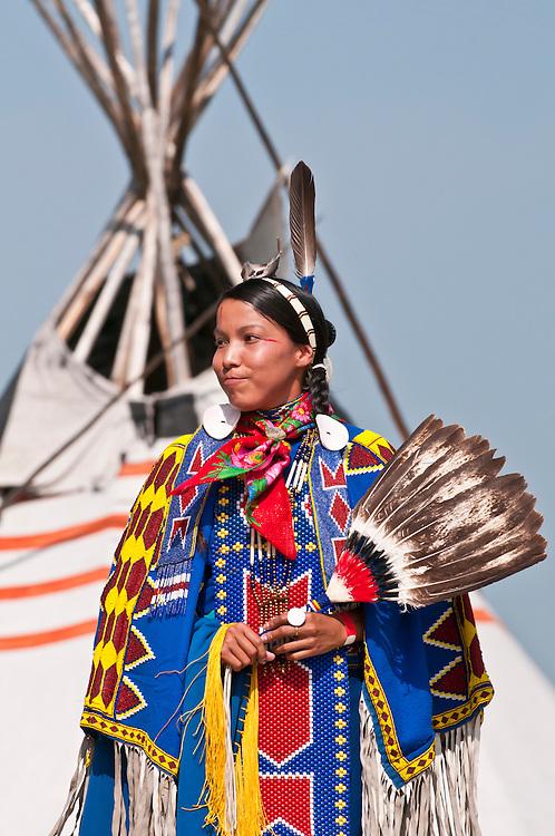 Female traditional dancer in beaded regalia, Pow-wow, Blackfoot Crossing Historical Park, Alberta, Canada