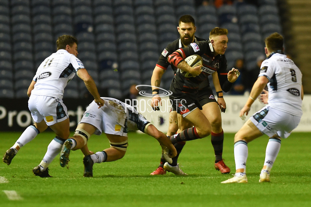 Dougie Fife escapes a tackle during the Guinness Pro 14 2017_18 match between Edinburgh Rugby and Glasgow Warriors at Murrayfield, Edinburgh, Scotland on 23 December 2017. Photo by Kevin Murray.