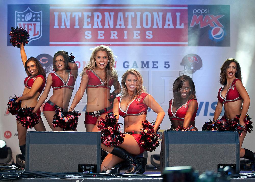 © licensed to London News Pictures. LONDON, UK  22/10/11. Tampa Bay cheerleaders performing at NFL Fan Rally in Trafalgar Square, London. Photo credit: TOLGA AKMEN/LNP
