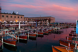 """Tahoe Concours d'Elegance Sunset 1"" - Photograph of classic wooden boats from the 2011 Tahoe Concours d'Elegance at sunset."