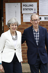 © Licensed to London News Pictures. 08/06/2017. Sonning, UK. Prime Minister Theresa May and her husband Philip cast their vote at a local polling station in the general election. Polling stations are open from 7am - 10pm. Photo credit: Peter Macdiarmid/LNP