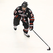 Dalen Hedges #27 of the Northeastern Huskies with the puck during The Beanpot Championship Game at TD Garden on February 10, 2014 in Boston, Massachusetts. (Photo by Elan Kawesch)