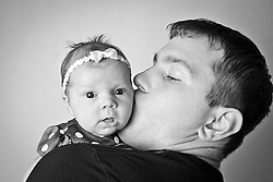 Bailey Jane Arnold at 1 month old with mother Mandy and father Joe.