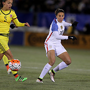 Carli Lloyd, (right), USA, dribbles past Isabella Echeverri, Colombia, during the USA Vs Colombia, Women's International friendly football match at the Pratt & Whitney Stadium, East Hartford, Connecticut, USA. 6th April 2016. Photo Tim Clayton