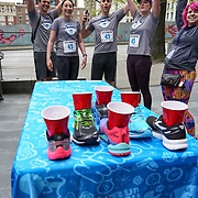 Seattle Sports Commission 5th Annual Seattle Urban Trek. Brooks shoe pong at Seattle City Hall. Photo by Alabastro Photography.