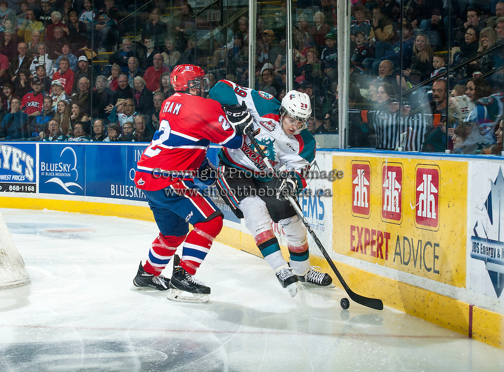 KELOWNA, CANADA - MARCH 7: Jason Fram #2 of Spokane Chiefs checks Leon Draisaitl #29 of Kelowna Rockets as he moves the puck behind the net on March 7, 2015 at Prospera Place in Kelowna, British Columbia, Canada.  (Photo by Marissa Baecker/Shoot the Breeze)  *** Local Caption *** Leon Draisaitl; Jason Fram;