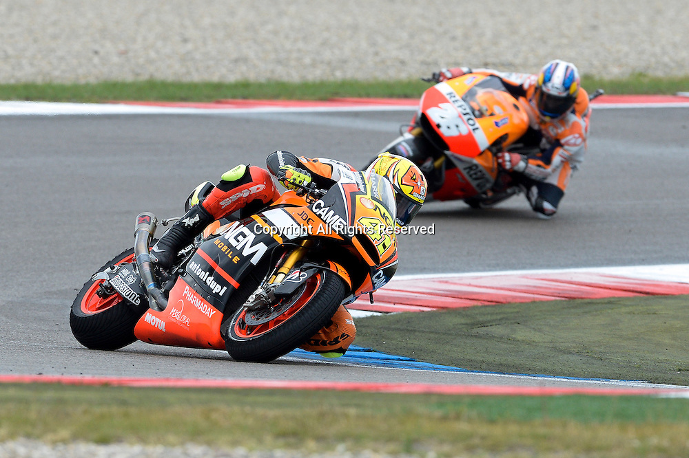28.06.2014.  Assen, Netherlands. MotoGP. Iveco Daily TT Assen Race.Aleix Espargaro (NGM Foward) and  Dani Pedrosa (Repsol Honda team) during the TT Assen race.