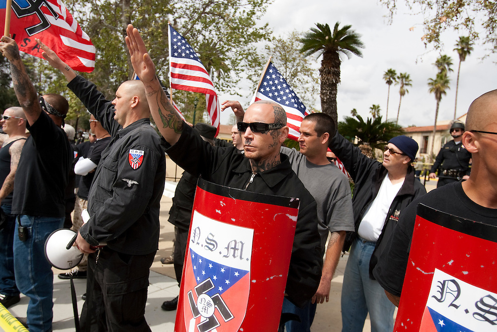Members of the National Socialist Movement, a Neo Nazi group, led by Southwestern Regional Director Jeff Russell Hall,holding megaphone at left, rallies in Claremont, California against illegal immigration. Please contact Todd Bigelow directly with your licensing requests.