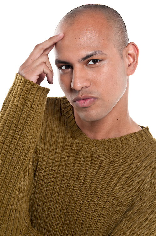 Young man thinking with serious look isolated.