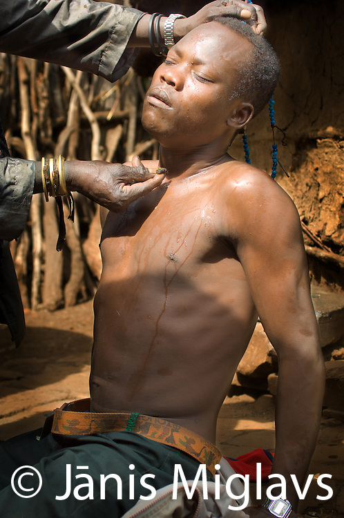 Traditional medicine man (witch doctor and known as god thief) and dream intrepreter, Gamara Moida, practices in Gaho village, Konso tribe, Omo region, Ethiopia