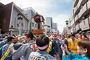 A large iron phallus on a mikoshi or portable shrine is paraded around the streets during the Kanamara matsuri or festival of the Steel phallus Kawasaki Daishi, Kawasaki, Kanagawa, Japan. Sunday, April 2nd 2017. The Kanamara Penis festival takes place on the first Sunday of April and celebrates the local legend of a penis eating demon who was defeated after being tricked into biting a steel phallus. The festival is popular with Japan's gay community and now uses its notoriety to raise money for HIV and AIDS charities. It is also wildly popular with foreign and Japanese.tourists.