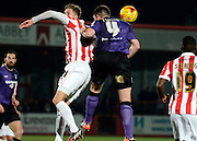 Morecambe's Alex Kenyon wins a header during the Sky Bet League 2 match between Cheltenham Town and Morecambe at Whaddon Road, Cheltenham, England on 16 January 2015. Photo by Alan Franklin.