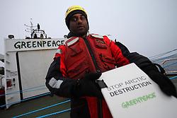 DAVIS STRAIT ABOARD ESPERANZA 16JUN11 - Greenpeace International executive director Kumi Naidoo of South Africa presents a petition containing 50000 signatures demanding the public release of Cairn Energy's oil spill response plan on the Greenpeace ship Esperanza in the Davis Stait off the coast of Greenland...Photo by Jiri Rezac / Greenpeace