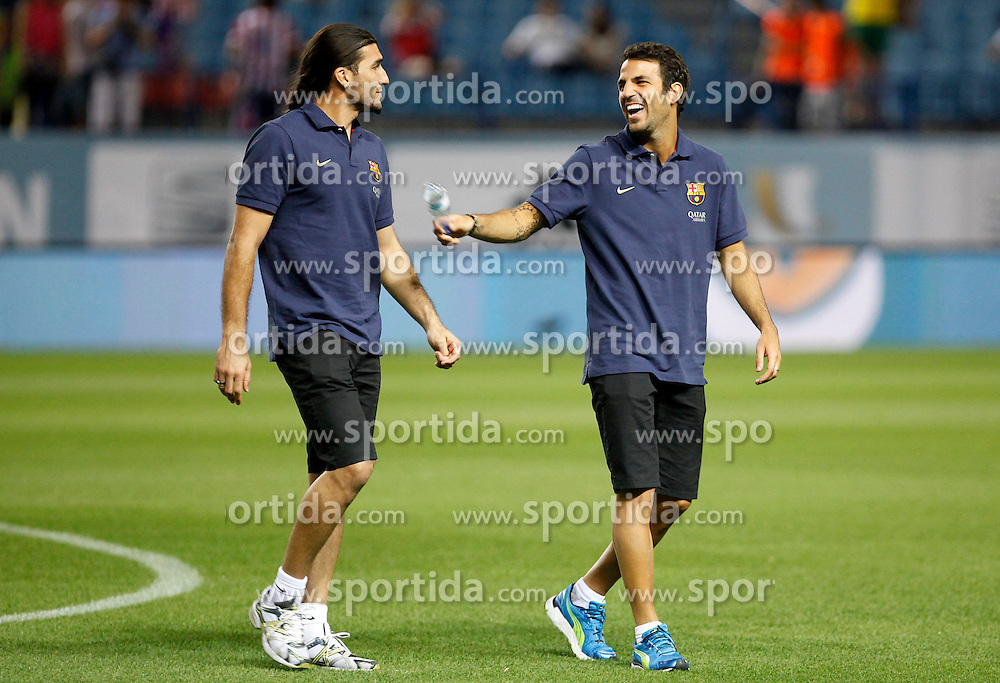 21.08.2013, Estadio Vicente Calderon, Madrid, ESP, Supercup, Atletico Madrid vs FC Barcelona, im Bild FC Barcelona's Jose Manuel Pinto (l) and Cesc Fabregas // during during the Spanish Supercup match between Club Atletico de Madrid and Barcelona FC at the Estadio Vicente Calderon, Madrid, Spain on 2013/08/21. EXPA Pictures &copy; 2013, PhotoCredit: EXPA/ Alterphotos/ Ricky Blanco<br /> <br /> ***** ATTENTION - OUT OF ESP and SUI *****