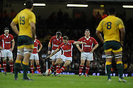 Leigh Halfpenny kicks a penalty for Wales.  Dove Men, autumn international test, Wales v Australia at the Millennium Stadium in Cardiff on Sat 1st Dec 2012. pic by Andrew Orchard, Andrew Orchard sports photography,
