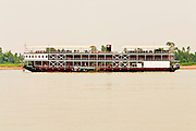 13 MARCH 2006 - CHAU DOC, AN GIANG, VIETNAM: The R.V. Mekong Pandaw in the Mekong River near Chau Doc in the Mekong River delta. The Mekong Pandaw, owned by the Irawaddy Flotilla Company, is the first river cruise on the Mekong between Vietnam and Cambodia and is a symbol of the burgeoning tourism industry in Vietnam and Cambodia. The ship carries about 64 passengers in 32 staterooms and makes weekly cruises from My Tho (near Saigon) to Siem Reap (Angkor Wat) in Cambodia. The Mekong is the lifeblood of southern Vietnam. It is the country's rice bowl and has enabled Vietnam to become the second leading rice exporting country in the world (after Thailand). The Mekong delta also carries commercial and passenger traffic throughout the region.  Photo by Jack Kurtz
