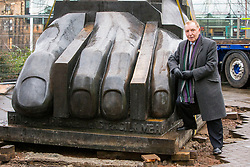 The largest of the three sculptures, The Foot, that makes up The Manuscript of Monte Cassino by Eduardo Paolozzi has been removed from its site on Edinburgh's Picardy Place to allow works on the new St James quarter.<br /> <br /> The work was commissioned by entrepreneur, Sir Tom Farmer and remembers the bombing during WW2 of the Monte Cassino monastery - close to the artists family home.<br /> <br /> Pictured:  Sir Tom Farmer poses by the sculpture before it is lifted
