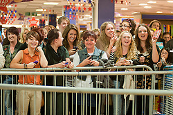 "Fans wait to see Leigh Francis in character as TV JUICE host Keith Lemon poses for photos with fans while signing copies of his new book. 'Keith Lemon: The Rules""  when he stopped in at WHSmith Meadowhall shopping centre in Sheffield. The event scheduled for 5:00 - 5:30 was so popular that Keith started signing early and didn't finish until 7:05pm as well as sales of the book being restricted.  .1st November 2011. Image © Paul David Drabble"
