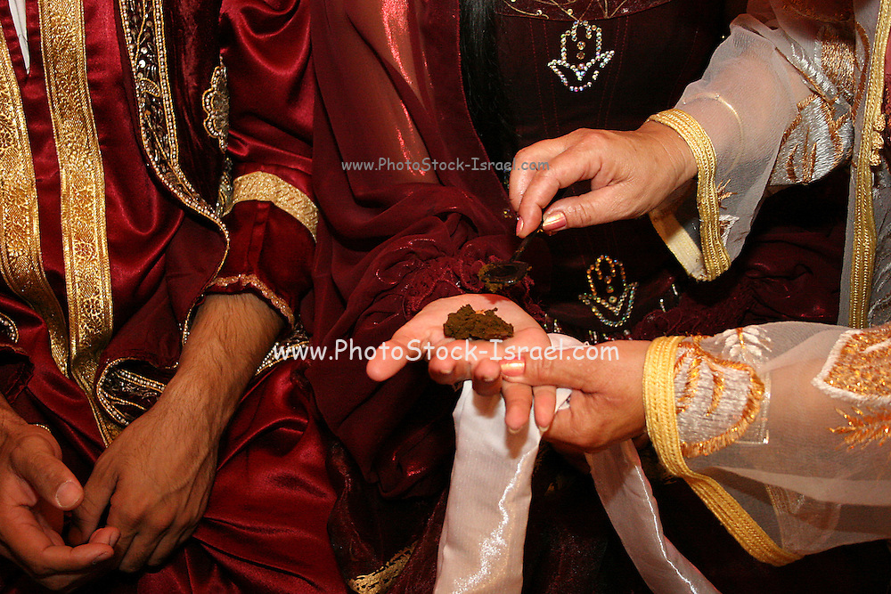 Henna applied on the brides hands <br /> The Hina, also Henna, ceremony proceeds the wedding day. In this festive ceremony, natural red dye is applied on the hands of the participants especially the bride and groom, to symbolize happiness, wealth and a successful union of the young couple.