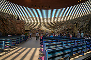 Helsinki, Finland -- July 19, 2019. Wide angle photo taken inside Rock Church in Helsinki, Finland, so called because the church is carved into a rock