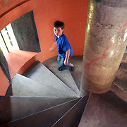 A boy climbs the spiral staircase of Durie Hill  Memorial Tower on Durie Hill, Whanganui is 33.5m tall and offer excellent views of the city, Tasman Sea, Ruapehu and Taranaki mountains. 27th December 2010.  Photo Tim Clayton..