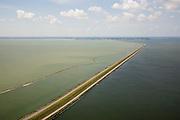 Nederland, Flevoland, IJsselmeer, 14-07-2008; Houtribdijk verbindt Enkhuizen en Lelystad en deelt het IJsselmeer in IJsselmeer en Markermeer (links), de foto is gemaakt richting Enkhuizen;  dijk is oorpronkelijk aangelegd om het Markeermeer in te polderen (Markerwaard), deze inpoldering maakte reeds deel uit van de Zuiderzeewerken; andere namen voor de dijk zijn: Markerwaarddijk, Lelydijk en Dijk Enkhuizen-Lelystad N302; toekomst, algen, licht, leeg, leegte, Lely, . .luchtfoto (toeslag); aerial photo (additional fee required); .foto Siebe Swart / photo Siebe Swart