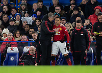 Football - 2018 / 2019 Emirates FA Cup - Fifth Round: Chelsea vs. Manchester United <br /> <br /> Ole Gunnar Solskjaer, manager of Manchester United, has words of encouragement with Alexis Sanchez (Manchester United) before he brings him on at Stamford Bridge<br /> <br /> COLORSPORT/DANIEL BEARHAM