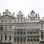 Guidhalls on the northern end of the Grand Place, Brussels. Originally the city's central market place, the Grand-Place is now a UNESCO World Heritage site. Ornate buildings line the square, including guildhalls, the Brussels Town Hall, and the Breadhouse, and seven cobbelstone streets feed into it.
