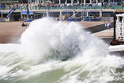 © Licensed to London News Pictures. 07/07/2015. Brighton, UK. strong wind and heavy waves are hitting major parts of the South Coast with few people visiting Brighton beach, today July 7th 2015. Big waves crashing in to the pontoon next to Brighton Pier. Photo credit : Hugo Michiels/LNP