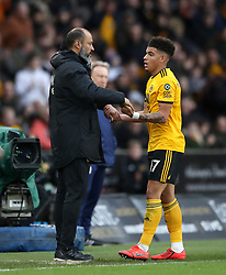 Wolverhampton Wanderers manager Nuno Espirito Santo (left) congratulates Morgan Gibbs-White as he is substituted during the Premier League match at Molineux, Wolverhampton.