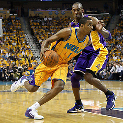 April 22, 2011; New Orleans, LA, USA; New Orleans Hornets small forward Trevor Ariza (1) drives past Los Angeles Lakers shooting guard Kobe Bryant (24) during the first quarter in game three of the first round of the 2011 NBA playoffs at the New Orleans Arena.    Mandatory Credit: Derick E. Hingle