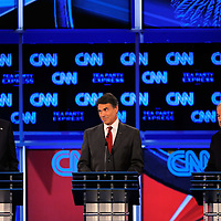 TAMPA, FL -- September 12, 2011 -- Republican Presidential candidates Gov. Mitt Romney, left to right, Gov. Rick Perry and Rep. Ron Paul argue during the CNN/Tea Party Republican Debate at the Florida State Fairgrounds on Monday, September 12, 2011.  Eight Republican Presidential candidates squared off with host Wolf Blitzer in the battleground state of Florida for the 2012 Election.    (Chip Litherland for The New York Times)