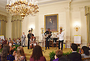 Esperanza Spaulding on stagte with Tomrbone Shorty  as a guest of Michelle Obama at the White House