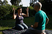Buddhists share spiritual thoughts during retreat at the Rivendell Buddhist Retreat Centre, East Sussex, England.