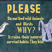 A warning sign asking visitors not to feed the animals at Lake Manyara National Park in northern Tanzania.