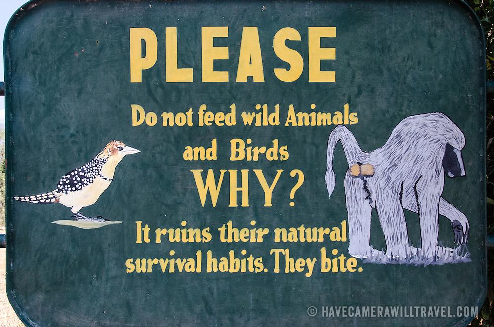 A warning sign asking visitors not to feed the animals at Lake Manyara National Park in northern Tanzania.
