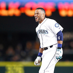 Seattle Mariners second baseman Robinson Cano (22) celebrates following a game winning RBI-single against the Detroit Tigers during the eleventh inning at Safeco Field.